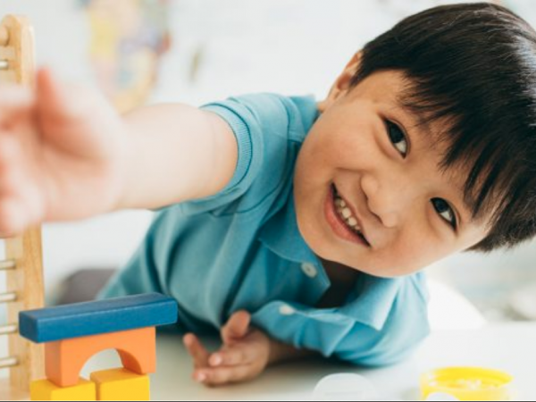 Boy playing with counting toy
