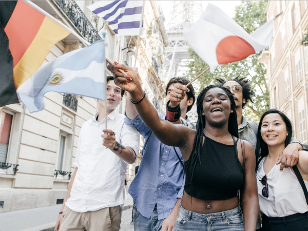 A group of international students waving country flags