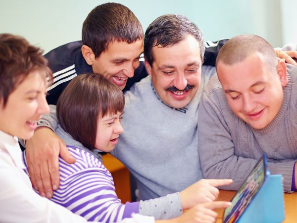 Family with a student with down syndrome in an iep meeting