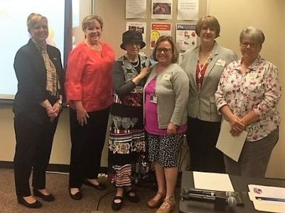 A group of people honored for outstanding Medicaid billing outcomes from MDH