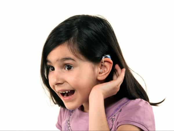 Young girl with a hearing aid