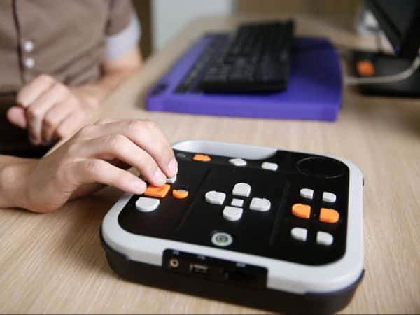 Person using an assistive technology reading device