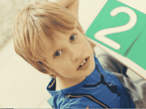 Image of a boy looking at the camera