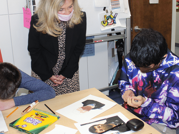 Marcella Franczkowski helps a student learn