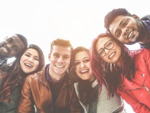 Group of young adults smiling at the camera