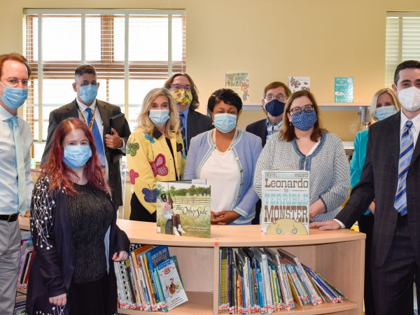 A group of people from the Lourie Center pose in the new media center