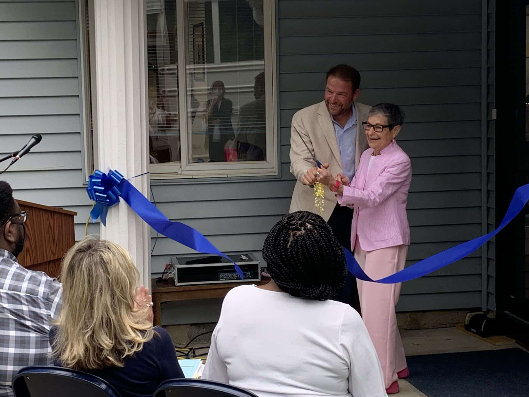 Dr. Jacobs cuts the ribbon