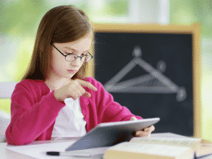 Young girl using a device doing a math problem